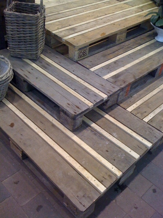10 diy projects from upcycled wooden pallets monday diy for Pallet patio floor